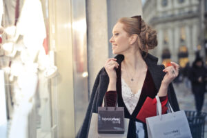 Canva - Woman Wearing Black Blazer Holding Shopping Bags